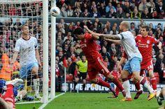 Luis Suarez scores against Aston Villa at Anfield