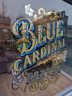 Gold leaf tattoo sign for Blue Cardinal Tattoo by Paul Banks. Hand drawn, hand painted and gilded. Custom design lettering and filigree. 23ct matt and bright gold leaf, variegated leaf, white gold leaf, mother of pearl and oil blended shades.