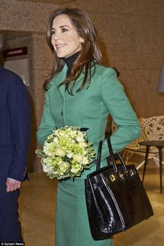 Luxury lady: Princess Mary's most expensive bag is her crocodile Hermes Birkin, which costs  $44,500 - pictured on a trip to Brussels in 2012