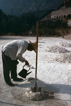 Eve Arnold - China. 1979. Mixing cement.