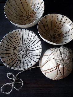 Pots with yarn pressed into to give it texture, inspires ideas for incising with all types of textures.