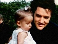 This has been photoshopped.  The original photo is Joe Esposito holding Lisa.  Elvis And Lisa Marie