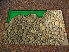 make your own ocean stone mat! fun for your feet and adds a nice ocean/natural touch to your home!  diy: just need smooth stones, hot glue, a welcome mat (preferably black or dark)