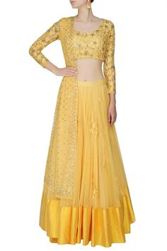 This set features a yellow lehenga in net base with threadwork floral motifs scattered all over and a broad silk border along the hem. It comes along with a mat