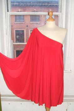 Baylis & Knight Red STUDIO 54 Batwing 70's Disco Glam One Shoulder Bat Wing Dress Elegant (Smock). £32.00, via Etsy.