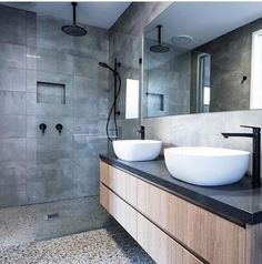 Concrete tiled walls with matte black rainfall shower head, matte black wall shower mixer, matte black rail shower. Timber wall hung vanity with dark grey concrete top. Twin top mounted vessels with matte black vessel mixers. Concrete Bathroom, Wooden Bathroom, Bathroom Faucets, Small Bathroom, Bathroom Ideas, Bathroom Mirrors, Grey Bathroom Wall Tiles, Polished Concrete Tiles, Concrete Walls