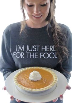 I'm Just Here For The Food Women's Fleece Sweatshirt - All the food. Pumpkin pie, sweet potatoes, turkey, ham, holiday cookies, bread rolls...  If you are looking for a humorous comfy sweatshirt to adorn yourself with this holiday season, snatch one of these up! They are extremely soft, and look great with jeans, yoga pants, or pj's.