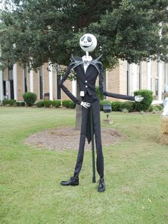 We made Jack Skellington from The Nightmare Before Christmas for a scarecrow contest. He is 7ft tall. His body is made of pvc pipe and his head is paper mache. His suit and tie were handmade.