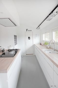 lovely white kitchen with just a touch of black. i love wood counters.
