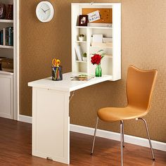 this could be a mini work space/ night stand next to bed on right side...Great idea for small spaces!
