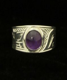 This hand carved sterling silver ring with amethyst stone is beautiful! Designed by Chris Cook, Northwest Coast First Nations artist. #ring #jewellery #silver #sterlingsilver