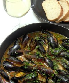 This recipe is my version of a very popular mussel dish from my favorite restaurant! The ingredient that makes this recipe so wonderful is the Sambuca, so do not leave it out! I have substituted Pernod and thought that was wonderful as well. Can be served as an appetizer or a main dish. Make sure you have plenty of crusty bread because you will want every last drop of the sauce! Enjoy! Wine Pairing: Domaine de lEcu Muscadet SAndegrave;vre et Maine Sur Lie 2003 with its yellow apple, lemon…