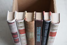 Make a hidden compartment out of book spines to store your secret stash