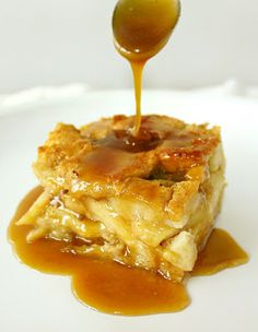 APPLE RUM BREAD PUDDING WITH BUTTERSCOTCH RUM SAUCE - top is a little crisp, inside is moist with a soft but firm-ish texture. The bread cubes soaking up all the custard-y goodness that only cinnamon and rum can bring, loaded with soft apples, it's sticky, gooey, sweet, and highly addictive.