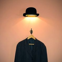 the jeeves wall lamp a classic gentlemans bowler that looks like it has been thrown black hat unique lighting