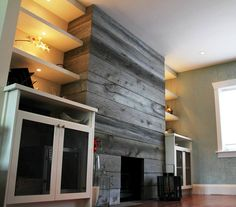 Barn Wood Wall Fireplace   Woodworks created this awesome fireplace surround using our barn ...