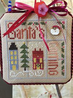 completed cross stitch Shepherd's Bush Christmas ornament Santa's coming