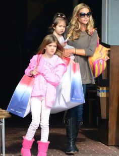 Denise Richards holiday shopping with her girls and toting our cat zoo pack!