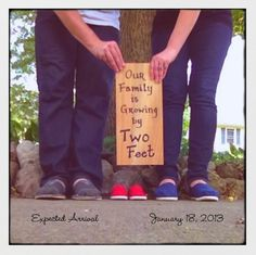 two feet baby shoes pregnancy announcement