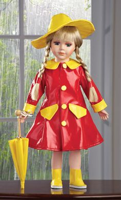 "Rain Showers Rachel Collectible  Porcelain Doll All set for any spring showers in her rain boots, hat and red raincoat, Rachel carries a matching umbrella. Her long blond hair is braided and she has a beautiful porcelain face, hands, and feet. Certificate of Authenticity included. Not a toy, for display only. Cotton, polyester, and porcelain; imported 16""H."