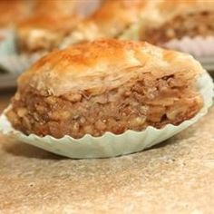 Baklava - Allrecipes.com - use Fr. Paul's shortcut of not buttering each dough layer.  Use this recipe for syrup with addition of zest from small lemon & 2 Tbsp of juice (reduced from last couple times you made this).  ~2 cups chopped nuts per pkg phyllo + ~1/3 c sugar + 1/2 to 1 tsp cinnamon.