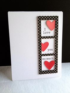 Love this film strip with black paper and white polka dots!  The hearts were cut from paint chip samples and layered to pop up a bit.  Sweet and simple on a white card base.  Handmade valentine's day card.