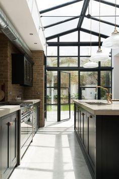 Devol Kitchen and crittal doors creating a dream kitchen in this modern extension with concrete worktops, brass taps and polished concrete floor adding industrial style Kitchen Inspirations, Home Decor Kitchen, Concrete Kitchen, House Design, House, Kitchen Flooring, Devol Kitchens, House Inspiration, Concrete Kitchen Floor