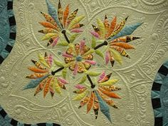 really beautiful #quilt that has a traditional feel to it. The quilting on the plain cream background gives it that old-fashioned style, but the color popping on the front is so modern!