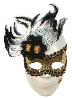 Designed and created by makeup artist, Suzanne Patterson. Mask makeup is Graftobian's Colored Latex in Black. Graftobian's Powdered Glitter in Gold is pressed into it. Black and Gold sequin fabric trim attached with eyelash glue. Gold rhinestones added along the top. Mask is lightly sprayed with Graftobian Glitterspray in Gold. Custom made feather flourish attached to the side and secured with Graftobian Liquid Latex in Black. A black and gold sequin beauty mark is applied with eyelash glue.