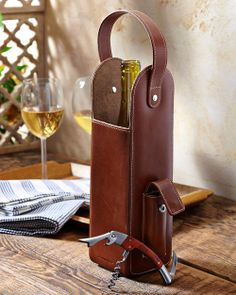 This leather carrier lets you tote your favorite merlot, chardonnay or other wine of choice in refined fashion. Designed to hold a single bottle, it's made from handsome natural grain leather for years of reliable use. A wide handle makes for comfortable carrying, while an included bottle opener is perfectly housed in the side pocket.