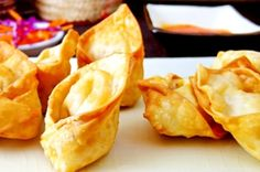 Crispy, golden, light little puffs of creamy crab filling. tell me there's anything tastier on a Chinese-American restaurant menu! Crab rangoon are not a traditional Chinese dish, but one of the. Appetizer Recipes, Snack Recipes, Dessert Recipes, Snacks, Appetizers, Desserts, Crab Puffs, Great Recipes, Favorite Recipes