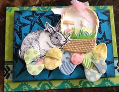 Handmade Easter card. Cute bunny with Easter basket and eggs,