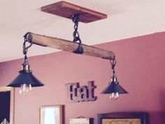 We took a single tree from a horse harness & added the lights for our new light over the stove & bar!