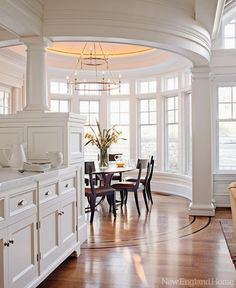 Nice kitchen, white trim, crown molding, love all the windows and light!