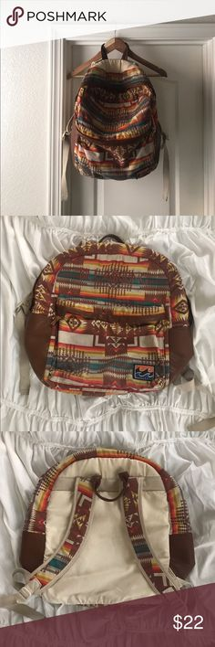 Billabong Boho Tribal Print Slouchy Backpack Boho tribal print slouchy backpack by Billabong. Purchased from SBI Boardshop. Was used mostly for a beach backpack; probably hasn't been outside for at least 6 months. Some regular fading/staining, small mark on the inside of the smaller pocket (gray paint) but blends in so much with the pattern I didn't take a photo of it. Inside has been vacuumed out! Fits a laptop. Still in awesome condition, lots of life left!!! Don't leave this sitting in my…