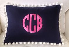 A personal favorite from my Etsy shop https://www.etsy.com/listing/199341531/monogrammed-pique-pom-pom-pillow-cover