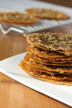A recipe for Dark Chocolate Oatmeal Lace Florentines; a knockoff of Trader Joes' chocolate lacey cookies!