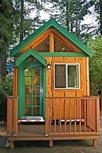 Outside shot with deck in down position. Outside shot with deck in down position. Front of house with deck down. Tiny Cabins, Tiny House Cabin, Tiny House Living, Tiny House Plans, Tiny House On Wheels, Cozy Living, Small Living, Small Buildings, Storage Buildings