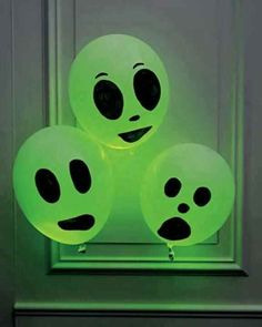 Spooky balloons nice...... Buy white balloons place a green glow stick in balloon, blow up balloon draw a spooky face and Walah.....scarey hey