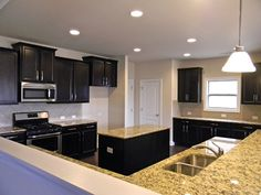 Katherine Kitchen. Timberlake Tahoe Maple Espresso Cabinets.  Santa Cecilia Granite. Standard backsplash board #19