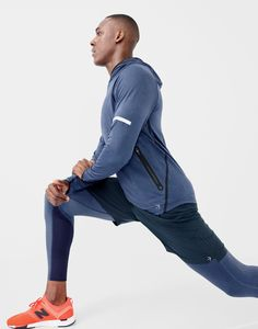 """New Balance® for J.Crew workout hoodie, 7"""" short, compression tights and New Balance® 247 Sport sneakers in orange."""