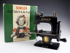 """Rare to find this charming little gem in this pristine condition and in the original box. A """"Singer SewHandy"""" model 20 sewing machine with the manual and instructions for doll dress style B. Appears to have never been used."""