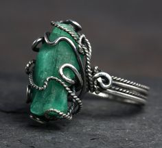 Love the way the raw emerald looks in the silver. Mmm.