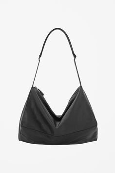 http://www.cosstores.com/us/Shop/Women/Accessories/Unstructured_leather_bag/7433-15237849.1.  This looks like a beloved, now deceased purse long gone. I need it!