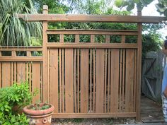 Japanese Fence by growingupcanto, via Flickr Vertical slatted wooden fence