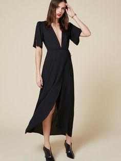 Plunging neckline and plenty of leg room - yes please. This is an ankle length, relaxed fitting dress with a deep v neckline.