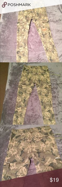 Camo Skinny Pants Never worn in Great Condition Kind of made like Skinny Joggers and Has Distressing  I got these while in Europe this Summer so that's why the Sizing says 34 (UK sizing) but it is an American 4. I am a Size 0/XS and these fit me fine. Fits Size 0-4 h&m Pants Track Pants & Joggers