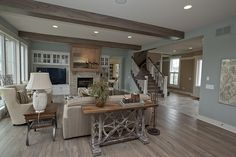 OMG - what a stunning room. The aqua walls, the white trim and beachy wood. Gorgeous!