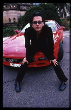 Michael Hutchence posing with a Ferrari, Sydney, Australia, 1996. Photo by Martyn. http://mobile.news.com.au/entertainment/tv/the-inxs-confession-kirk-pengilly-kept-secret-for-16-years/story-e6frfmyi-1226835416750