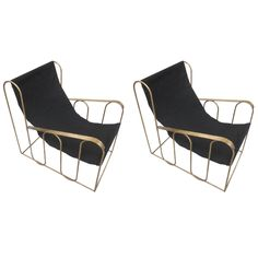 Pair of French Lounge Chairs in the Style of Jean Royere | From a unique collection of antique and modern armchairs at https://www.1stdibs.com/furniture/seating/armchairs/